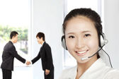 Smiling businesswoman customer service on the phone — Stock Photo