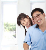 Smiling asian girl and father — Stock Photo