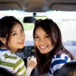 Happy girls in the car and enjoy driving — Stock Photo