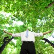 Relaxed businessman stand in the forest — Stock Photo #7230106