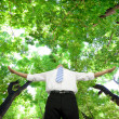 Relaxed businessman stand in the forest — Stockfoto