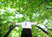 Relaxed businessman stand in the forest — Stock Photo