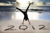 Happy new year 2012 on the beach with sunrise — Stok fotoğraf