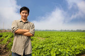 Chinese middle aged farmer and his farm — Stock Photo
