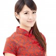Smiling beautiful chinese young woman with tradition clothing — Stock Photo