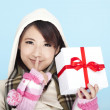 Winter portrait of a smiling woman with a gift box — Stock Photo
