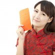 Pretty chinese young woman holding red bag for happy chinese new year — Stock Photo