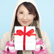 Winter portrait of smiling asian woman with a gift — Stock Photo