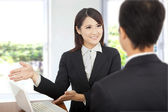 Smiling Business woman showing at laptop and explaining a plan of work to c — Stock Photo