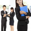 Smiling  businesswoman in office — Stockfoto