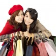 Happy asian girls holding shopping bag — Stok fotoğraf