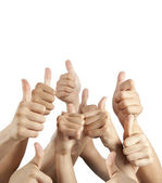 Many different hands with thumbs up isolated on white — Stock Photo