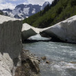 Avalanche bridge across mountain river — Stock Photo