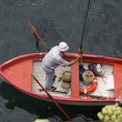 Fisherman in boat - Stock Photo