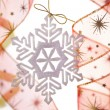 Christmas decoration with snowflake and ribbons — Stock Photo