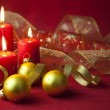 Christmas decoration with candles and ribbons — Stock Photo #7556977