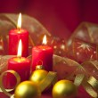 Christmas decoration with candles and ribbons — Stock Photo #7556990