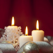 Christmas decoration with candles and ribbons — Stock Photo #7557013