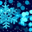 Christmas decoration snowflake  on defocused lights and stars ba — Stock Photo
