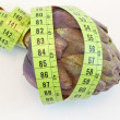 Stock Photo: Artichoke with metric tape