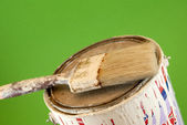 Tin of painting and brush — Стоковое фото