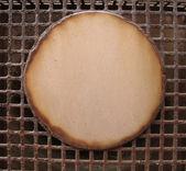 Circle round rust shape on rusty grid — Stock Photo