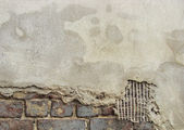 Partially restored concrete and brick worn grunge wall — Stock Photo