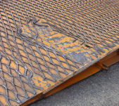 Detail damaged orange ramp truck trailer for car transport — Stock Photo