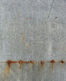 Elegant rust stripe and leak on a gray grunge metal surface — Stock Photo