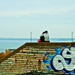 Royalty-Free Stock Photo: A couple sitting on the brick wall.