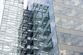 Glass facade building detail reflecting sky. — Stock Photo