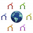 Colored houses around earth on white background — Stock Photo