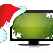 Monitor with dressed cap Santa - Stock Photo