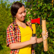 Young woman holding an axe and chock — Stock Photo #6799020