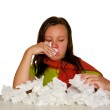 Young woman blows her nose — Stock Photo