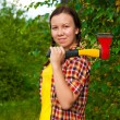 Young woman carrying an axe — Stock Photo #6805955