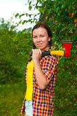 Young woman carrying an axe — Stock Photo