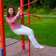 Happy young woman on playground — ストック写真