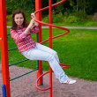 图库照片: Happy young woman on playground