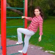 Happy young woman on playground — Stock Photo