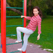 Happy young woman on playground — 图库照片