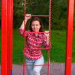 Happy young woman on playground — Stockfoto