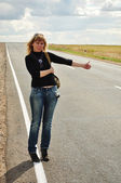 Woman hitchhiking, Road Trip — Stock Photo