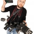 Photographer with many cameras — Stock Photo