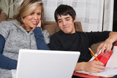 Young couple doing schoolwork — Stock Photo