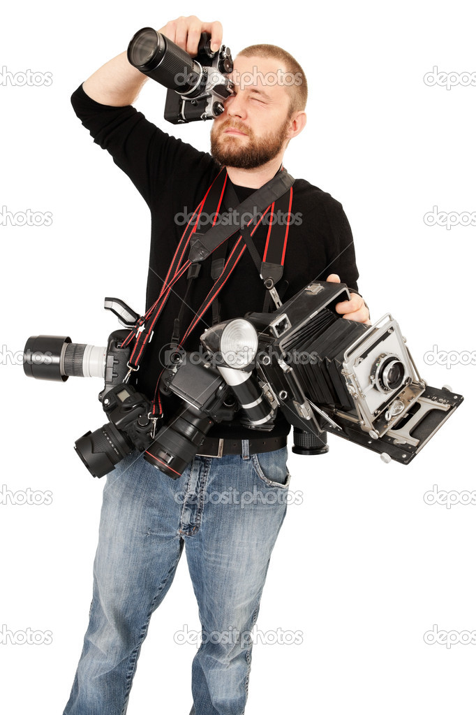 Photo of a man in his late twenties, standing and holding many cameras, film, digital, medium format and large format. — Stock Photo #7673738