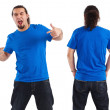 Male pointing at his blank blue shirt — Stock Photo #7727675