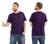 Male posing with blank purple shirt — Stock Photo