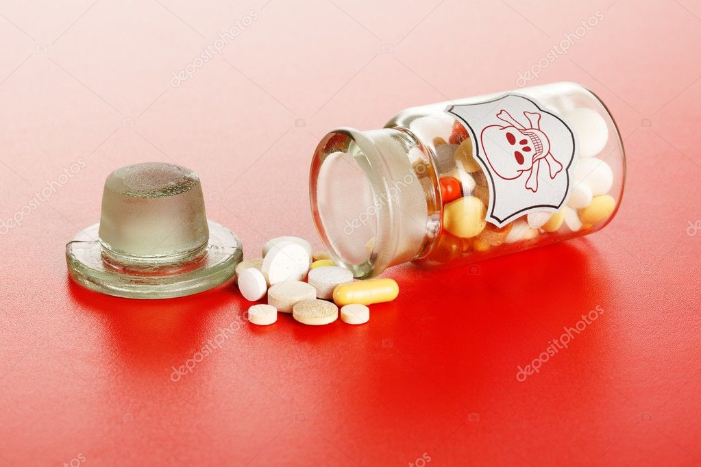 Poisonous chemical pills spilled out of vintage labeled chemical bottle with skull — Stock Photo #7026350