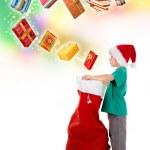 Little boy opening Santa bag with wonderful presents — Stock Photo